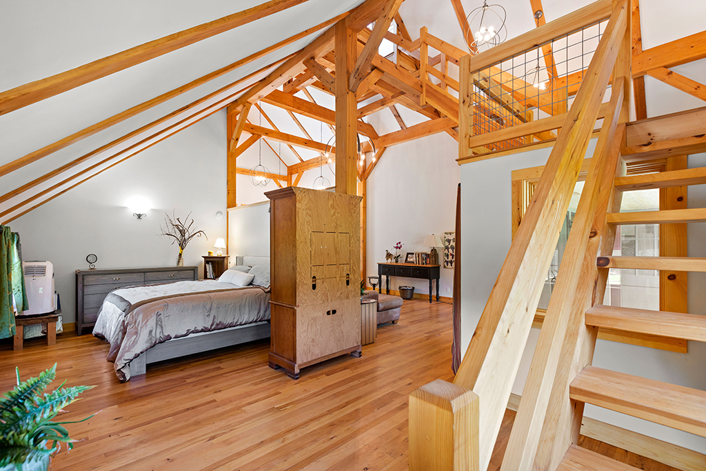 Finished interior of a timber frame home with a staircase