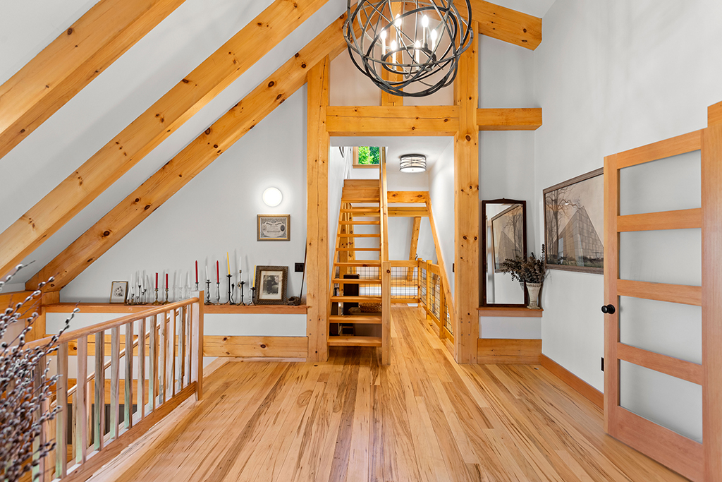 Finished interior of a timber frame hallway and staircase