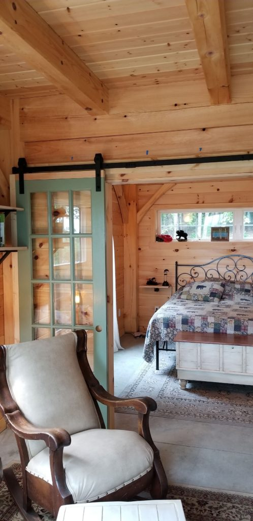 Finished interior of a timber frame camp