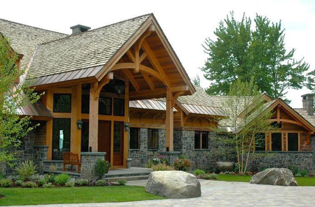 Finished timber frame barn next to a timber frame garage