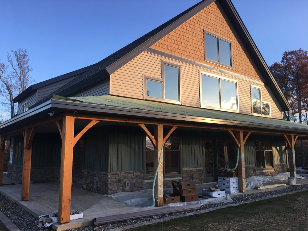 Finished exterior of a timber frame cape