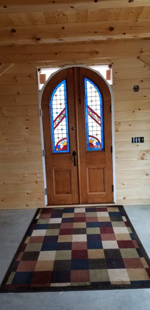 Finished interior doorway of a timber frame camp