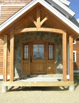 Finished Timber Frame Cape exterior in Stow, MA