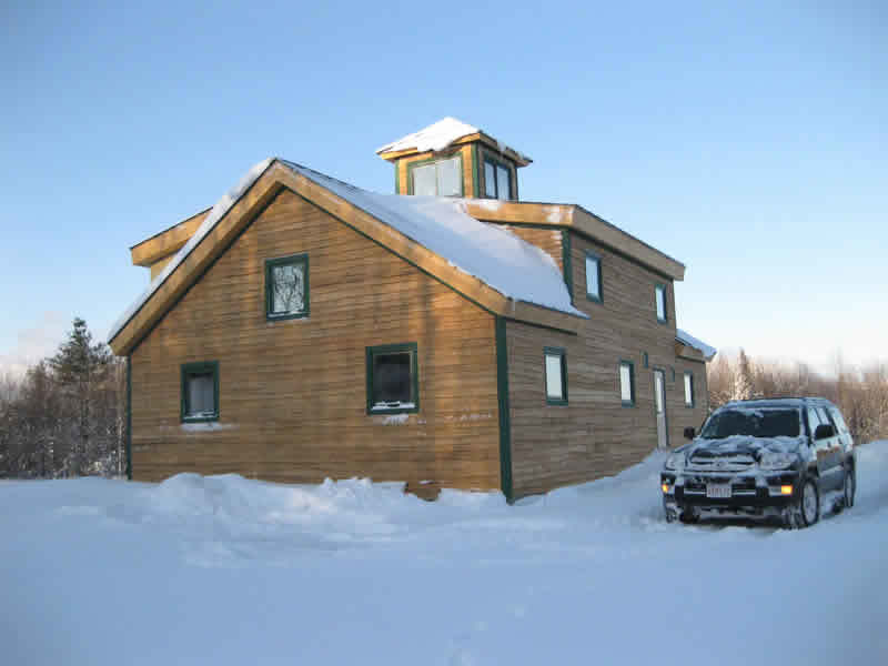 Finished exterior of a timber frame custom cape
